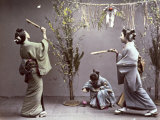 Young Geishas in Traditional Costume Playing 'Hanetuki' Photographic Print