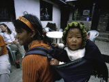 Small Baby on the Back of Young Girl, Nepal Prints by David D'angelo