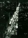 View of New York Illuminated at Night, Traffic Stretches for Miles as Cars Pour into the City Photographic Print