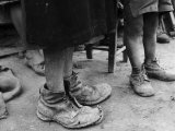 Old Shoes on the Feet of Children, Oliveto Lucano Photographic Print