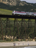 The Coast Starlight Passes over a Trestle Bridge near Santa Barbara, California Photographic Print by Phil Schermeister