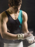 Male Gymnast Putting Chalk on his Hands, Bainbridge Island, Washington State, USA Reprodukcja zdjęcia