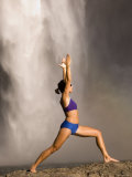Young Woman Practicing Yoga on a Rock, Snoqualmie Falls, Washington State, USA Reprodukcja zdjęcia