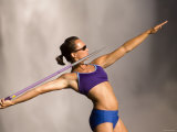 Young Woman Throwing a Javelin, Snoqualmie Falls, Washington State, USA Photographic Print