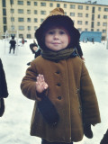 A Young Girl Holds Up Four Fingers to Signal Her Age Photographic Print by Dean Conger