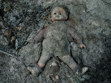 Mud-Covered Doll at a South Florida Landfill Photographic Print by Joel Sartore