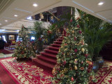 Christmas Trees at the Bottom of an Elegant Stairway on a Cruise Ship Photographic Print by Todd Gipstein