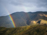 A Rainbow Appears to Touch the Ground in This Landscape View Photographic Print by Joel Sartore