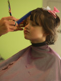 A 6-year-old Girl Gets a Haircut Photographic Print by Stephen Alvarez