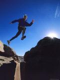 Running on a Sandstone Ridge Above Bluff, Utah Reproduction photographique par Bill Hatcher