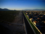 A Road Divides a New Housing Development from the Desert Photographic Print by Maria Stenzel