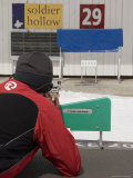 A Man Shoots at a Target in the Distance During a Biathalon Photographic Print by Taylor S. Kennedy
