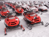 A Row of Snowmobiles Sit Waiting for the Next Adventure to Start Photographic Print by Taylor S. Kennedy