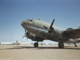 A C-46 at the Airport in Rio De Oro Photographic Print by Maynard Owen Williams