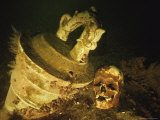 The Skull of One of the Tragedys 800 Victims Lies Near One of the Ships Cannons Photographic Print by Bill Curtsinger