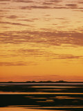 The Sky and Water Turn Golden as Twilight Settles over the Indian Ocean Photographic Print
