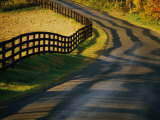 Twilight View of a Wooden Fence and its Shadow Along a Country Road Photographic Print by Kenneth Garrett