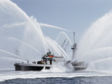 A Fireboat Sprays Jets of Water Photographic Print by J. Baylor Roberts