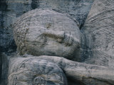 The Head of a Forty-Four-Foot-Long Granite Statue of a Reclining Buddha Entering Nirvana Valokuvavedos