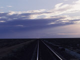 Railroad Tracks Disappear into the Australian Outback Region Photographic Print
