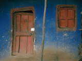 Faded Blue and Red Paint Cover the Entrance to a Dwelling in Addis Ababa Photographic Print by Jodi Cobb