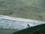 Bikers Travel Across the Rough Terrain and Melt Ice of Southern Alaska Photographic Print by Roman Dial