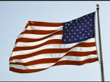The American Flag Waves in the Breeze Photographic Print by Stephen St. John