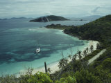A Boat Anchored Along the Beaches of Virgin Gorda Photographic Print by Todd Gipstein