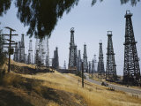 Oil Rigs Line the Road Near Long Beach Photographic Print by Willard Culver