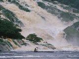 A Man on a Canoe Near the Crashing Waters of Kongou Falls Photographic Print by Michael Nichols