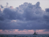Distant Sailboat under Dramatic Clouds Photographic Print by Robert Madden