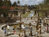 A University of Miami Art Class Paints Near a Fountain Photographic Print by Willard Culver