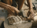 Worker Hammers Silver Ingots Photographic Print