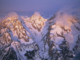 Clouds Rise from the Peaks of Three Mountains in the Teton Range Fotografisk tryk af Paul Chesley