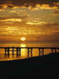 Sunset over a Silhouetted Dock Photographic Print by Clarita Berger