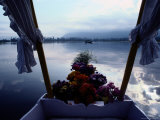 Flowers Decorate the Back End of a Small Boat Photographic Print by Sam Abell