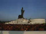 Monks Gather at a Statue of Buddha for a Kings Birthday Celebration Photographic Print by Jodi Cobb