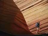 A Hiker Walks Through a Sandstone Gorge Photographic Print by Dugald Bremner Studio