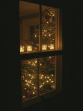 View of Candles and a Christmas Tree Through a Window Photographic Print by Roy Gumpel
