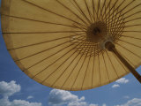 An Umbrella Blocks the Sun on a Phuket Island Beach Photographic Print by Jodi Cobb