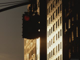 A Traffic Light Near Sunlit High-Rises Shines Red Photographic Print by Roy Gumpel