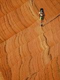 A Hiker Backpacks on Sandstone Photographic Print by Dugald Bremner Studio