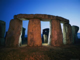 A View of Stonehenge Silhouetted by Lights at Twilight Photographic Print by Richard Nowitz