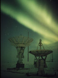 Antennas Point Skyward under the Glowing Aurora Borealis Photographic Print by Norbert Rosing