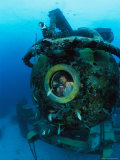Scientist Greg Stone Peers out of One of the Windows on Aquarius Photographic Print by Brian J. Skerry