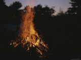 A Pile of Brush Burns Brightly in the Deepening Dusk Photographic Print by Roy Gumpel