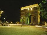 Traffic Whizzes Past Pariss Arc De Triomphe at Night Photographic Print by Raul Touzon
