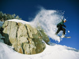 Snowboarder Jumping off a Big Rock Photographic Print by Skip Brown