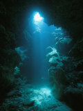 A Beam of Sunlight Illuminates an Underwater Cave Fotografie-Druck von Raul Touzon
