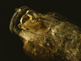 Close View of a Gilded Mummy Found in a Bahariya Oasis Tomb Photographic Print by Kenneth Garrett